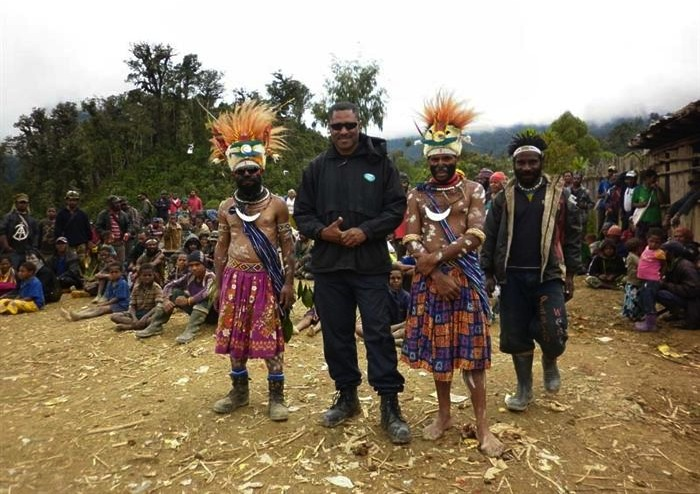 INDOCHINE's country manager, George Niumataiwalu, at Mt Kare in Papua New Guinea. In January, Indochine completed a land boundary walk with local clans ahead of a mining lease application in August. Credit: Indochine Mining