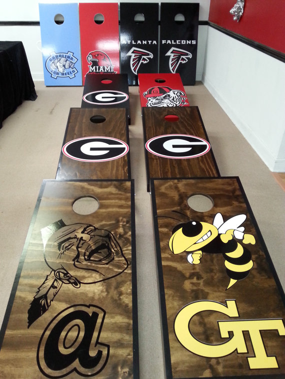 Cornhole boards designed with logos of sports teams