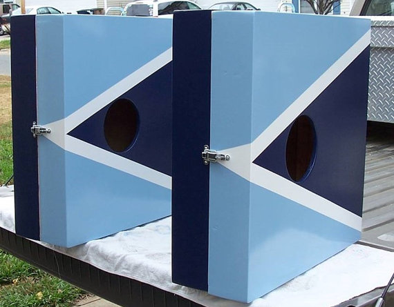 Customizable cornhole board that folds up for easy transportation.