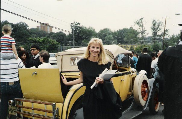 Amber posing next to Georgia Tech's Ramblin' Wreck after graduating from college.