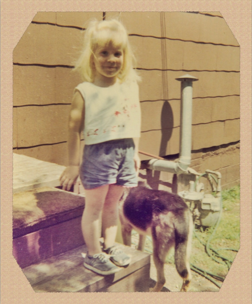 I came into this world loving dogs. Here is one of the only photos I have of me and King, a German Shepherd we lost during a thunderstorm.