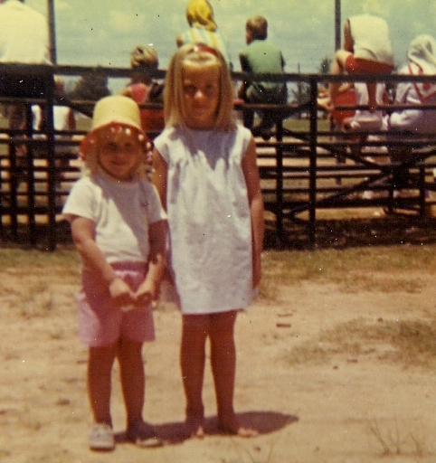 Amber (with goofy hat) and Audrey (with stylish headband) at the baseball field circa 1969.