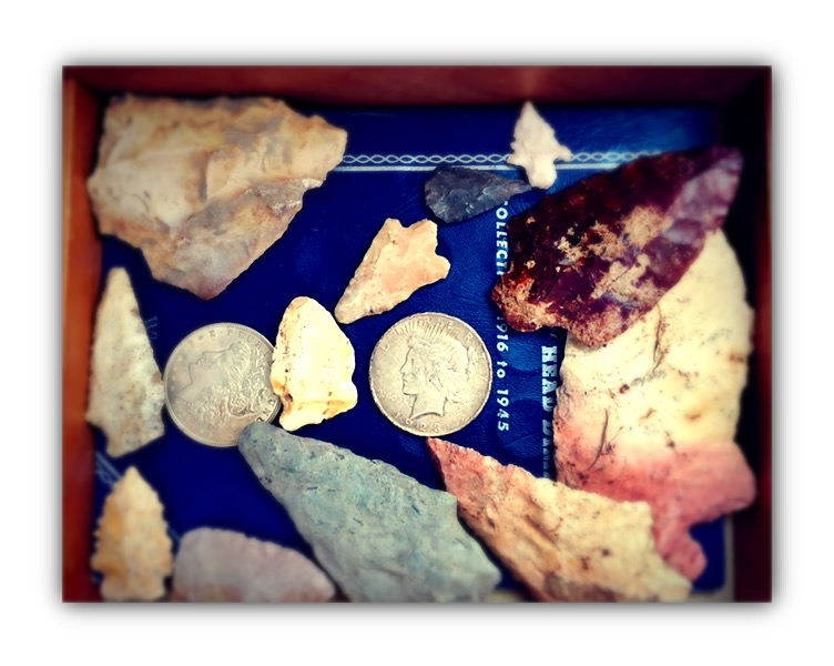 A few arrowheads and coins I keep in a wooden keepsake box in my office—reminders of my father.