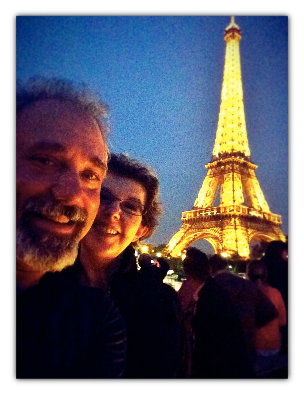 David and Pauline Aft posing with the grand Eiffel Tower.