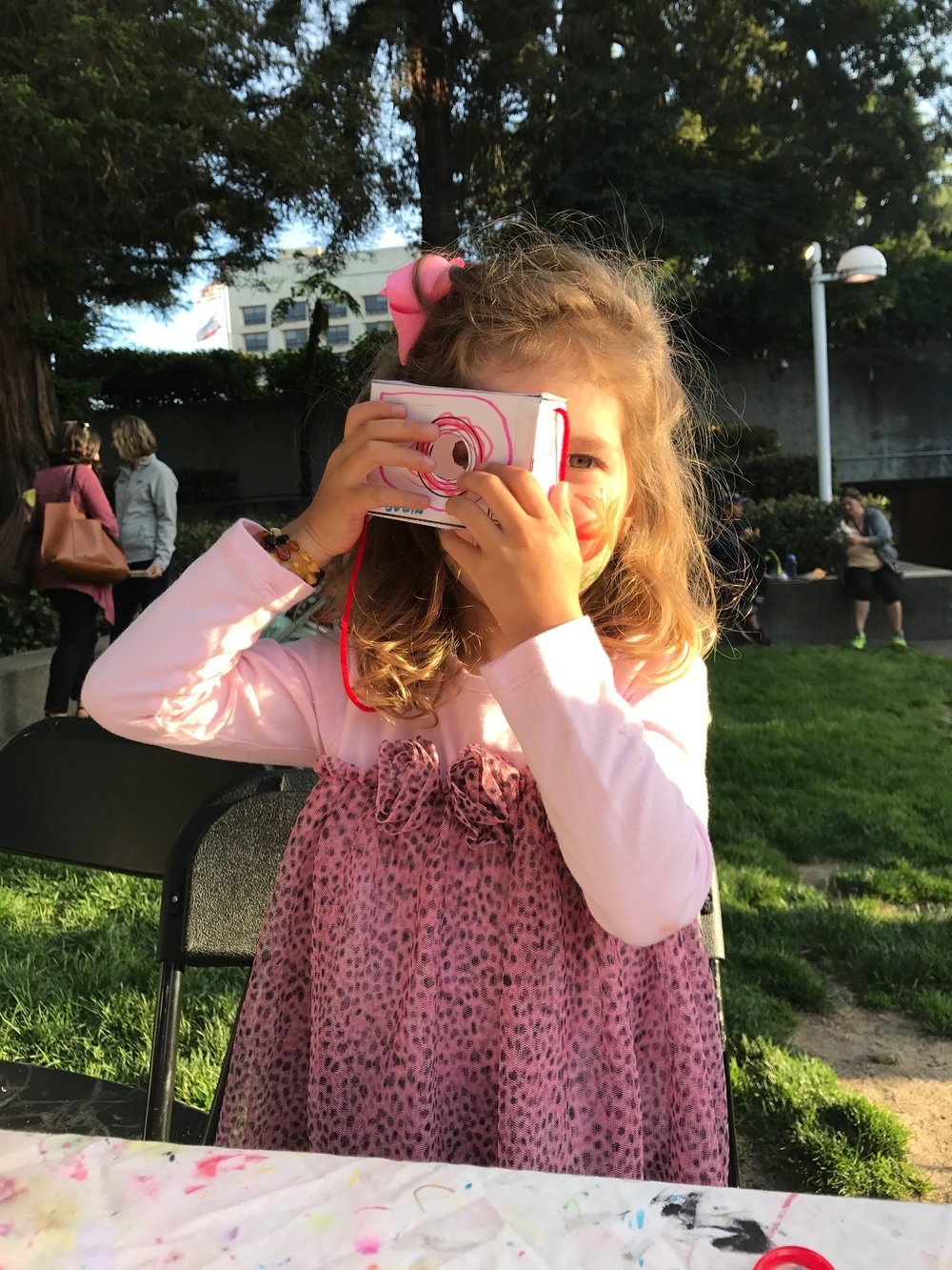 Young visitor displaying her paper camera-2.JPG