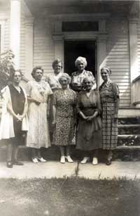 Fiftieth anniversary: Charlotte Hobbs and ladies on front steps.