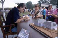 Stephen King signing book of young fan