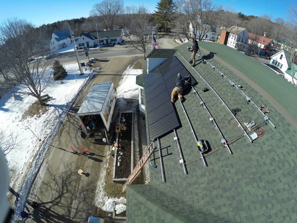 ReVision Energy installing solar panels on a balmy February day in 2016.