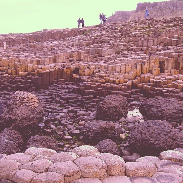 The Giant's Causeway is an area of 40,000 interlocking basalt columns on the northern coast of Northern Ireland resulting from an ancient volcanic eruption. It is declared a World Heritage Site by UNESCO. Photo by Shannen Garza.