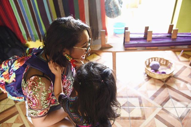 Exchanging fashion advice with the tiniest Guatemalan. She was obsessed with my earrings! This co-op was a weaving space run completely by women. They handcrafted all of their scarves and they were absolutely beautiful. | Photo by @nadshakim  #travel #travel2019 #travelgram #instatravel #travelblogger #culture #photography #photooftheday #travellingthroughtheworld #thecolorspectrumproject #guatemala #panajachel #lakeatitlan