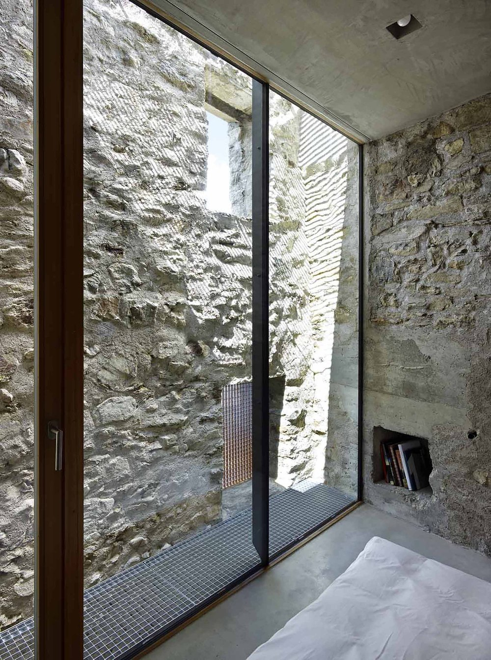 543dd5a6c07a80762d00024b_stone-house-transformation-in-scaiano-wespi-de-meuron-romeo-architects_1430_cf030063.jpg