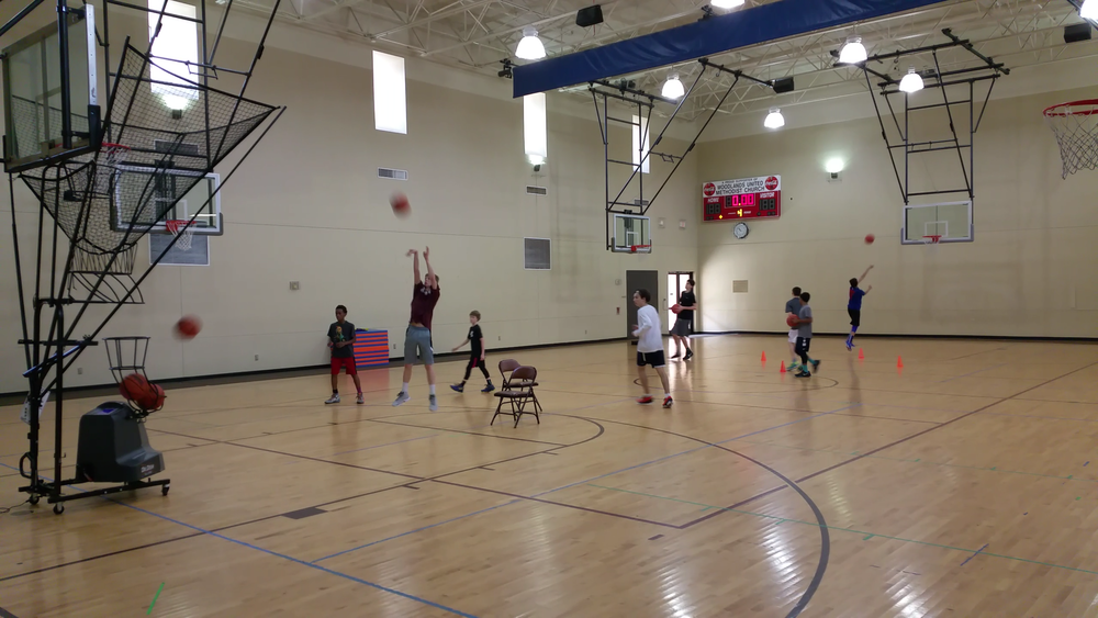 Modern Basketball uses the latest in shooting machine technology (Dr. Dish)to maximize reps in our group shooting drills!