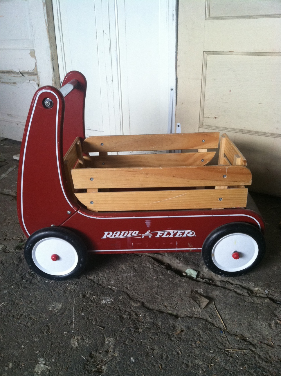 Vintage style child wagon. Perfect for that little one that can't quite walk down the aisle. $20 rental