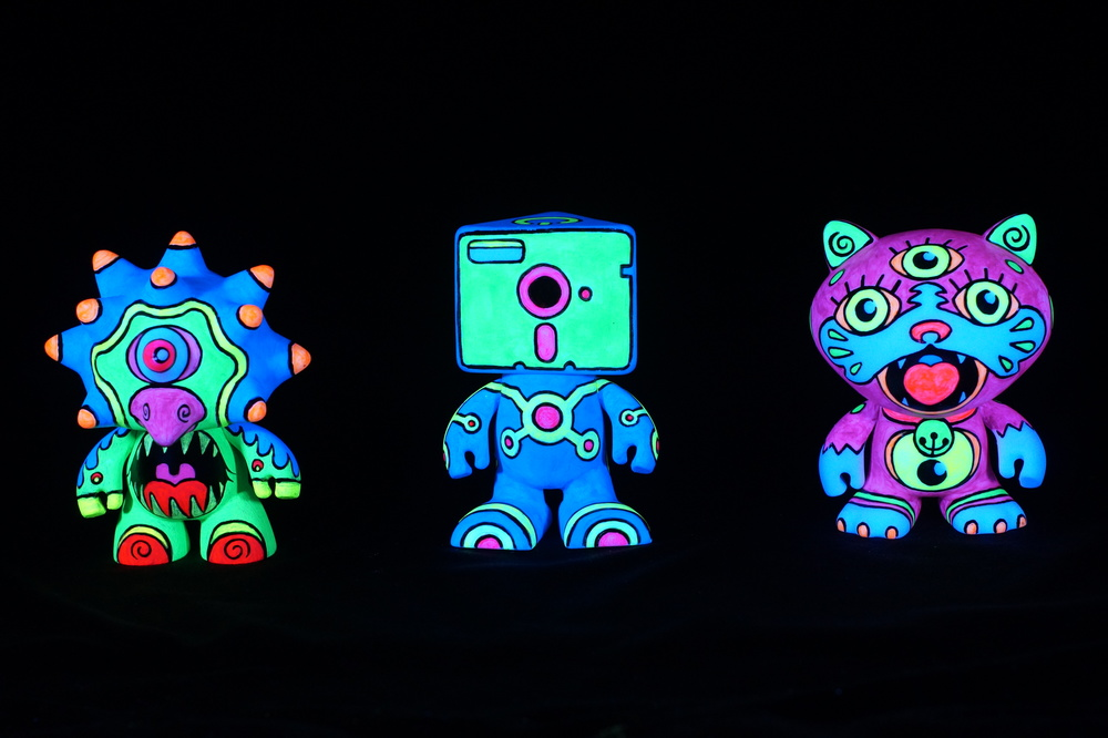 """neon TOYS"" - 4"" ht,   black-light acrylic on  pre-molded vinyl figures"