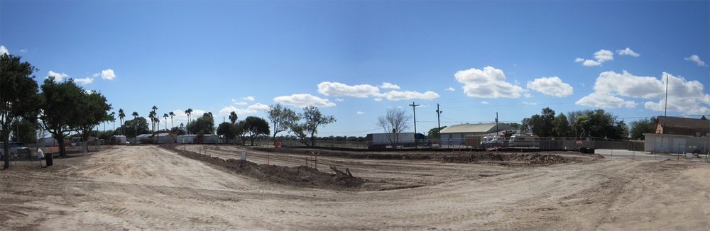 Standing at the northwest street corner facing the building pad of the first 10 houses.