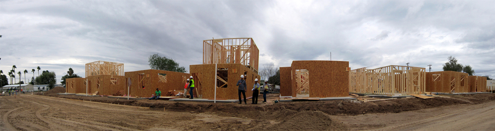 The first eight homes being framed and sheathed.