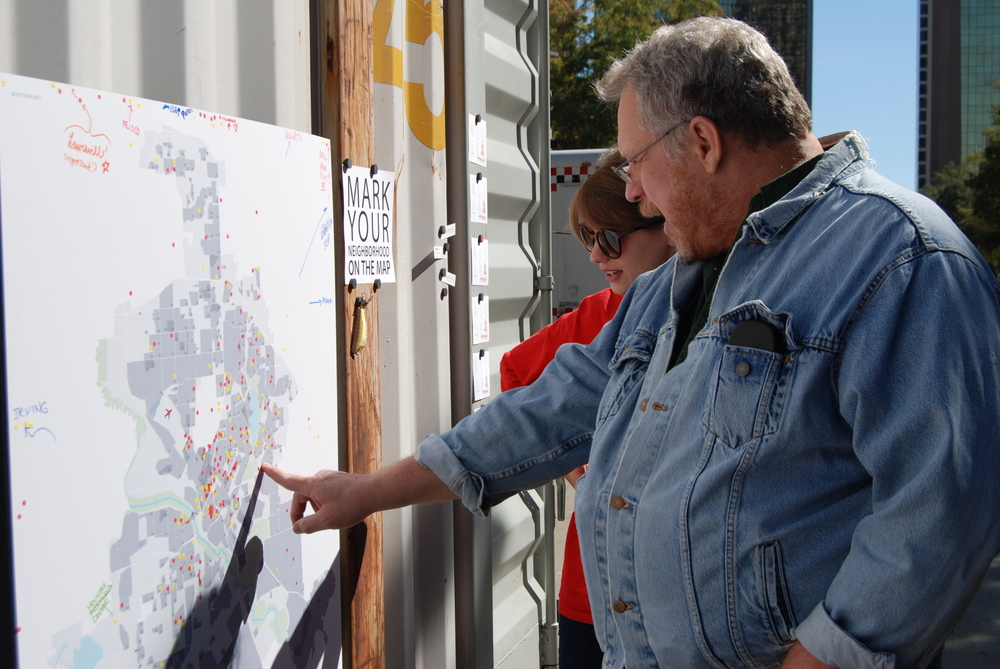 A visitor explains Buckner Terrace's historic boundaries on the City Map