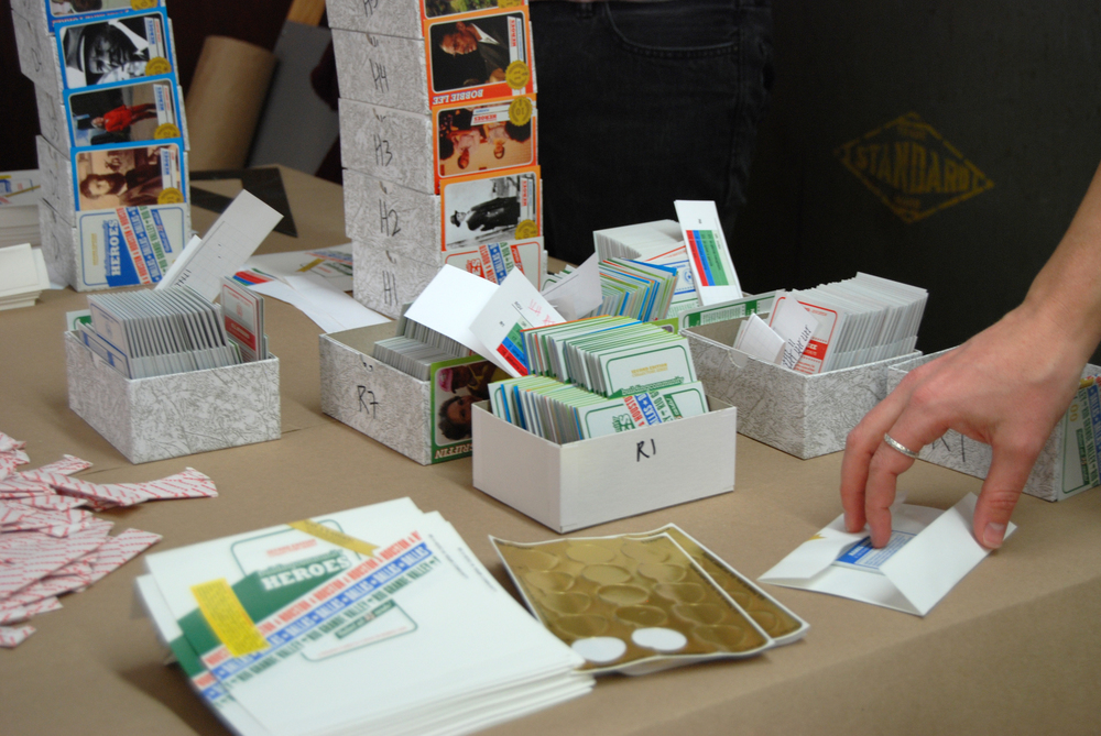 The assembly process involved origami-level folding techniques to combine the cards with a stick of gum.