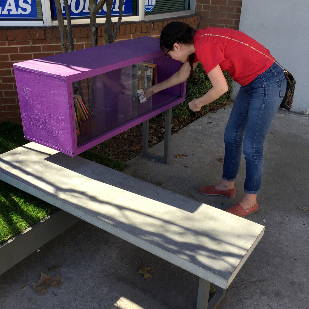 Lisa Neergaard leaving several packs of cards in the Lakewest YMCA's Little Free Library in Dallas.