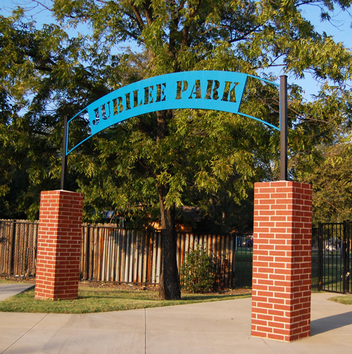Jubilee Park, in East Dallas near Fair Park, is announced by this metal and brick archway.