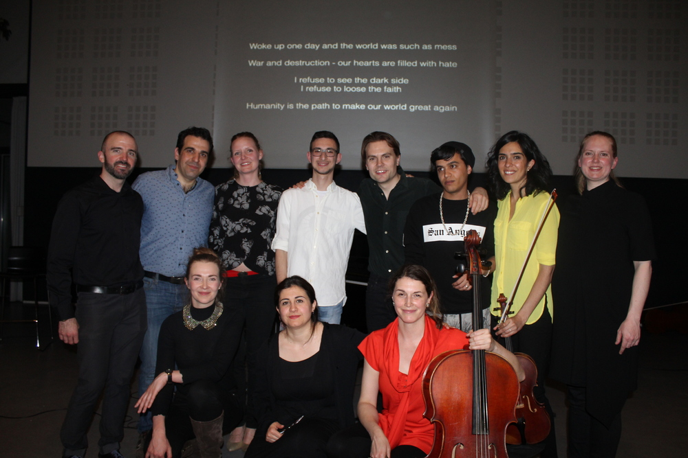 Members of Lydenskab, Decoda, and four recent refugees to Denmark. The lyrics of the final song projected behind us.