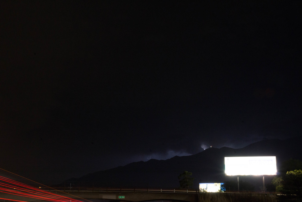 The lightning storms silhouettes the mountains.