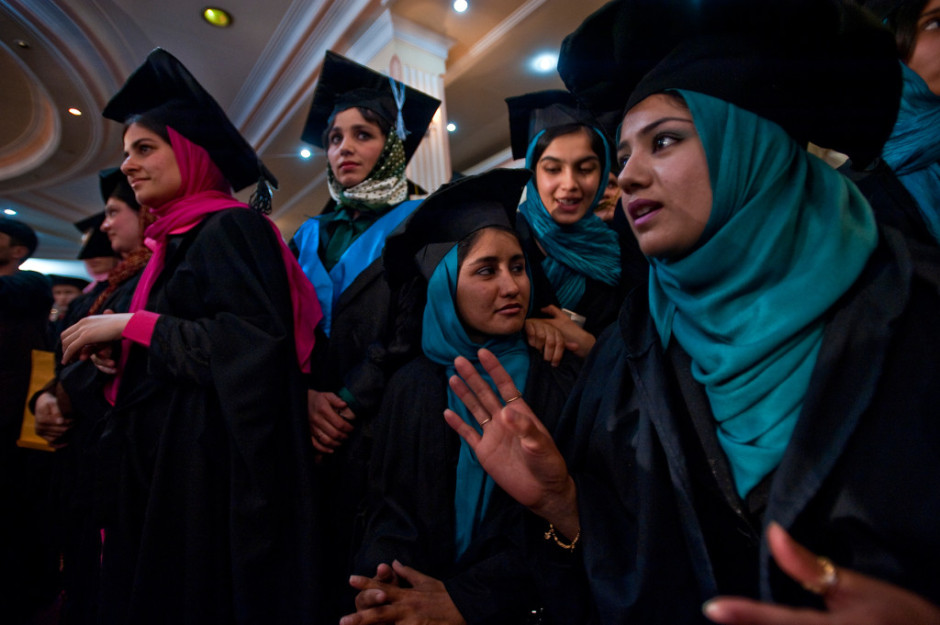 Wearing hijabs under their mortarboards and seated in separate rows from their male peers, the women pictured are graduates of the department of language and literature at Kabul University..jpg