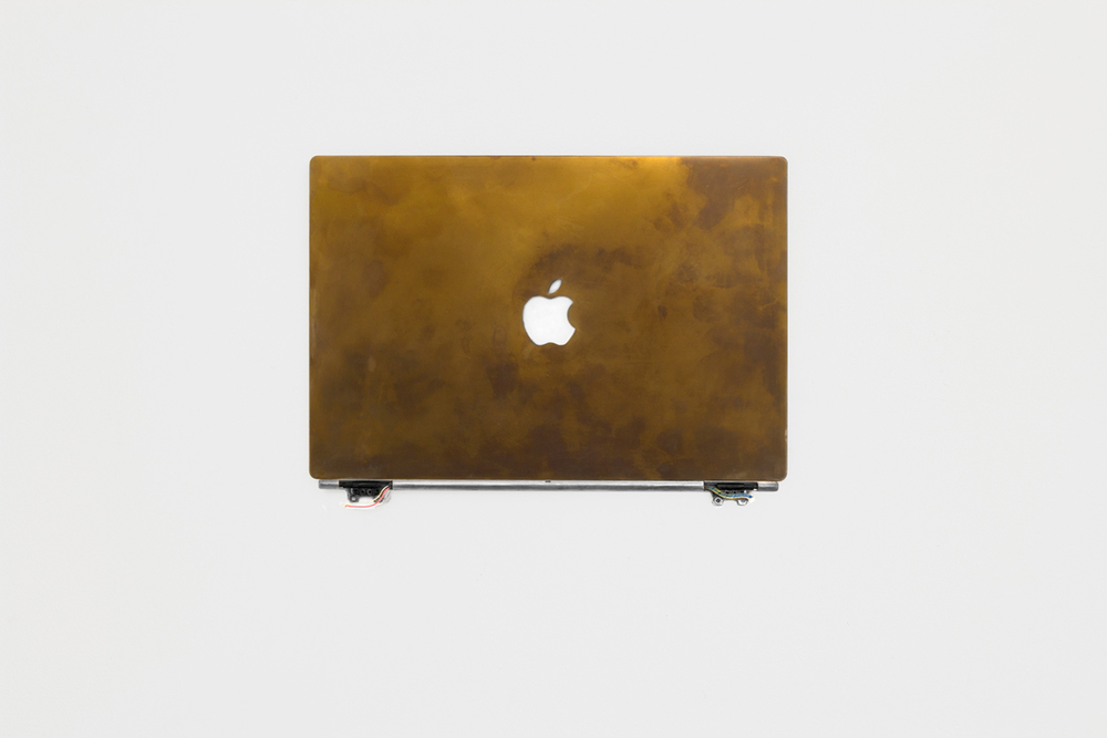 Calculated Optimism (a),  2014, Anodized Apple PowerBook G4 Titanium computer, 34 x 24 x 3 cm