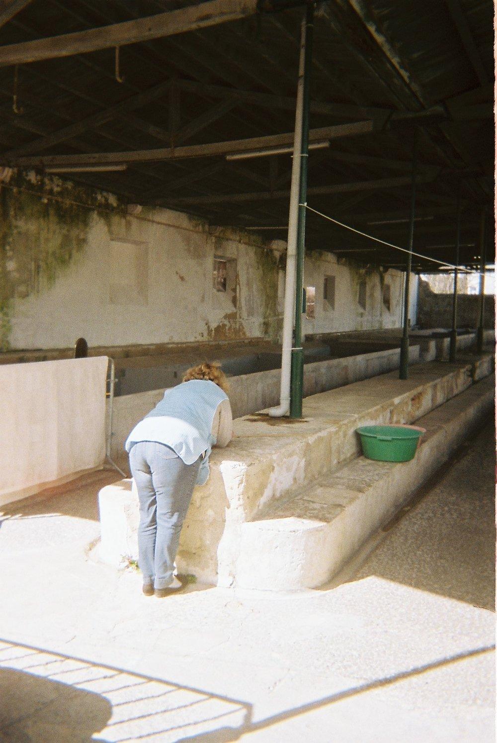 Dona Fernanda at the public washhouse