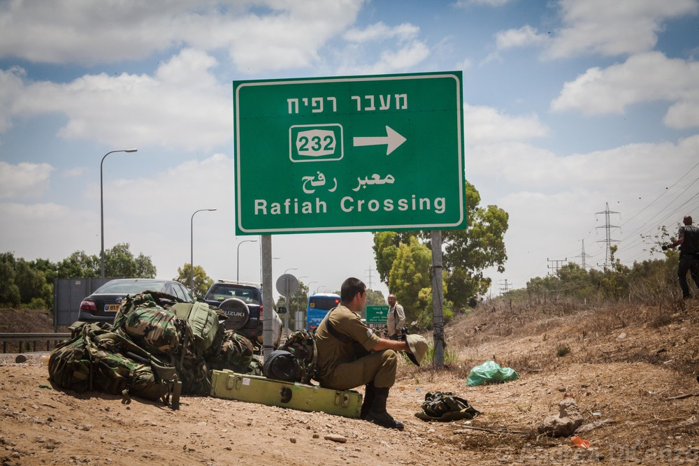 A soldier waits with equipment on the Israel/Gaza border as the ground incursion begins for Operation Protective Edge. An additional 18,000 soldiers are being called up to the border of Gaza to supplement the 40,000 soldiers already in position.