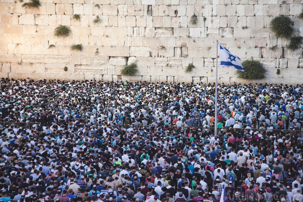 A prayer vigil at the Western Wall brings thousands to come and pray for the safe return of the three missing teenage boy's four days after they went missing.