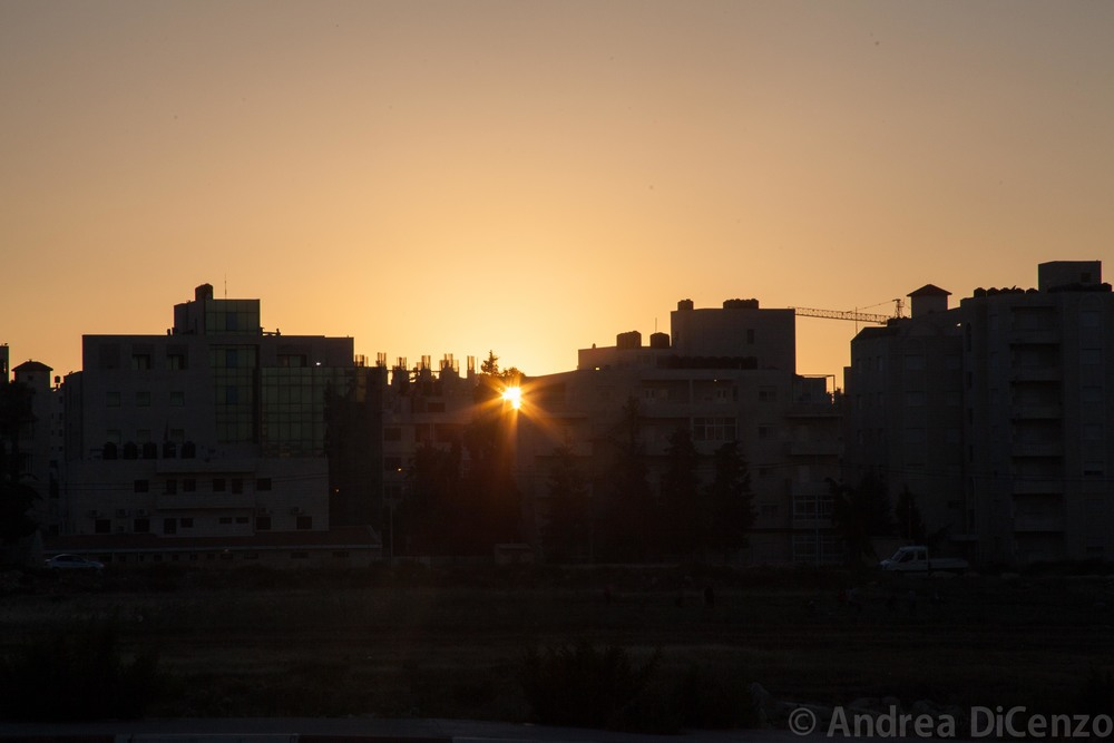 The sun sets in a peaceful Ramallah as the war in Gaza rages on just miles away.