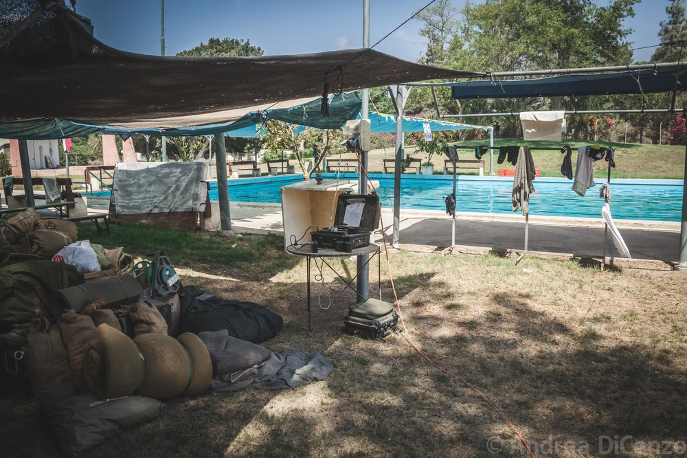 A community pool in kibbutz Nirim is now a temporary home stay to thirty to forty soldiers - many who are from the surrounding region. Because Nirim is in direct and constant threat from Gazan militants, soldiers have been stationed at the kibbutz to ensure additional safety and provide emergency response teams.
