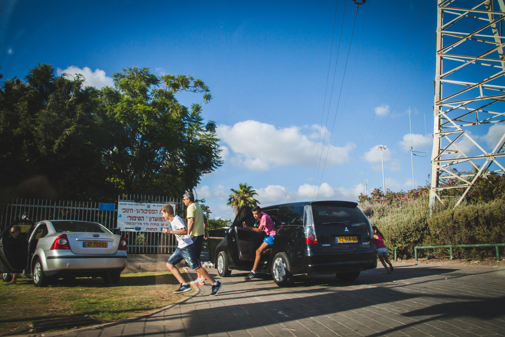 Families get out of their vehicles and run for cover as Red Alert sirens signaling on coming rockets from Gaza go off in Tel Aviv during Operation Protective Edge.