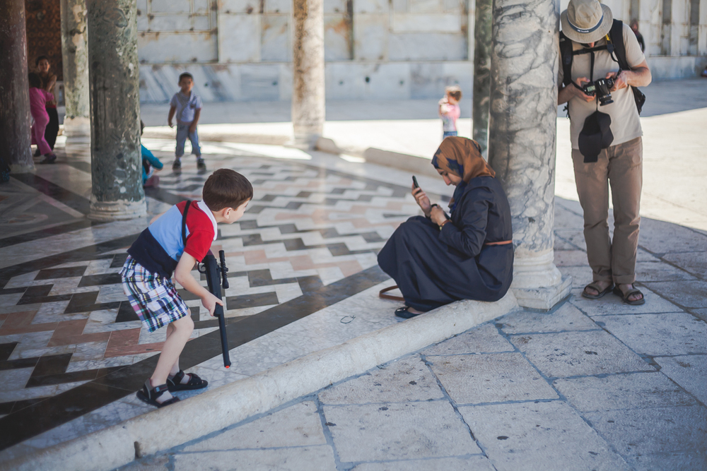 A child plays with a toy rifle at Al-Aqsa Mosque in Jerusalem.