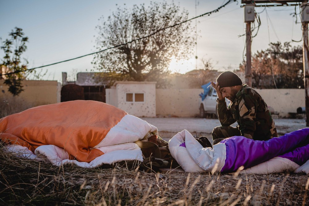 Peshmerga soldiers wake up in the morning after the two battle with ISIS militants to take back the city of Sinjar.