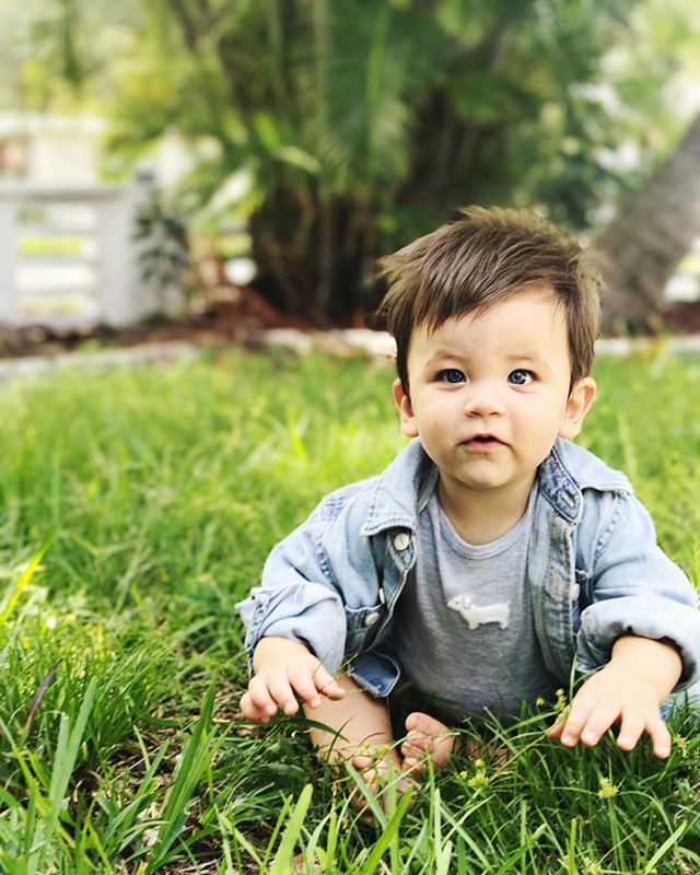 "Celebrated this little spark of life all day today on his 9 month birthday! - I thank God every day for the distinct privilege to raise this gem of a boy @shiloh.isaac - our ""Prince of Peace and Laughter"". - I have photographed little moments every day of his life and today had to have been one of my favorites. Sitting on the thick Florida grass at my parents vacation home his eyes darted between airplanes passing in the sky, the blades of grass and sandy dirt, and me yapping at him to smile for the camera-  I captured his sweet, observing and curious spirit. God bless this little man ✨✨#shilohisaac #9monthsold #birthdaygram"