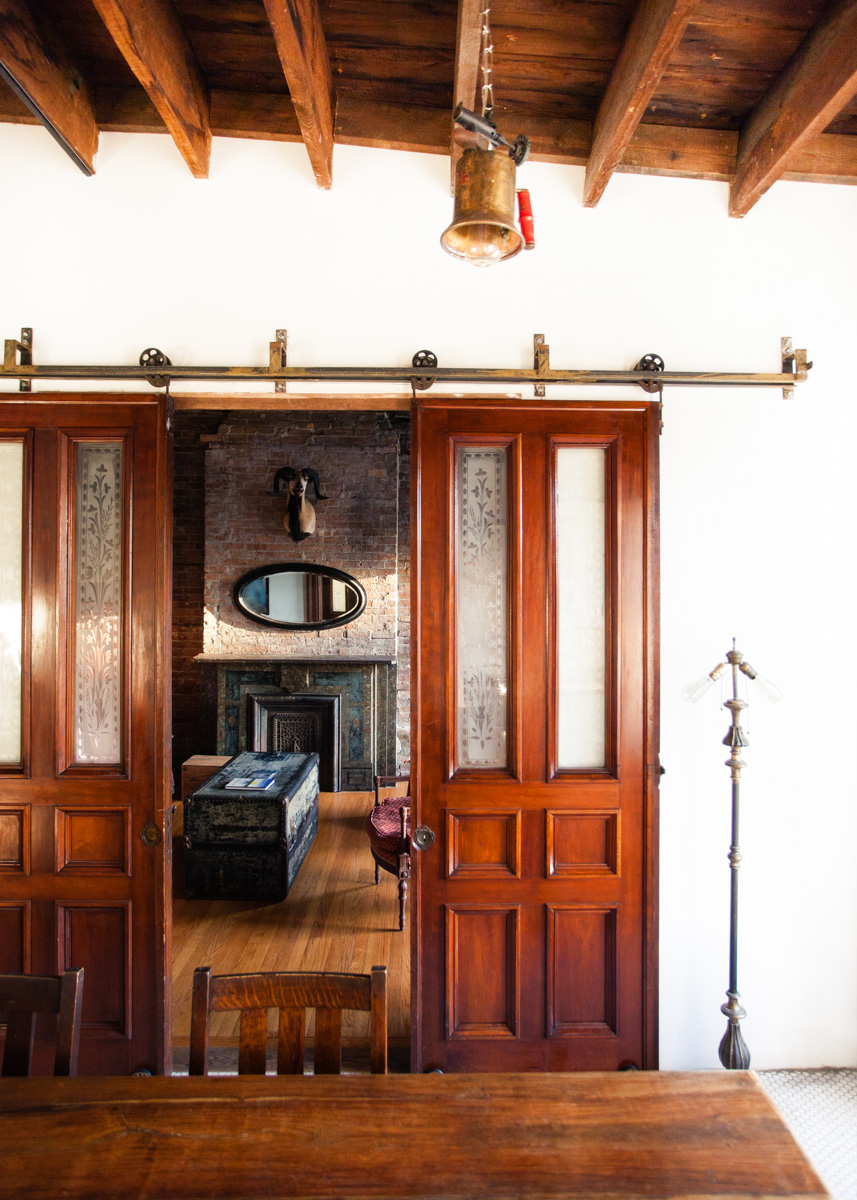 The building's original mahogany doors have been repurposed as sliding barn-style doors.