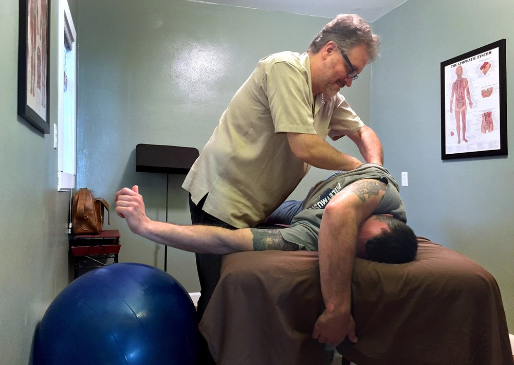 Andy uses Myofascial Release Therapy (MFR) to treat a client.