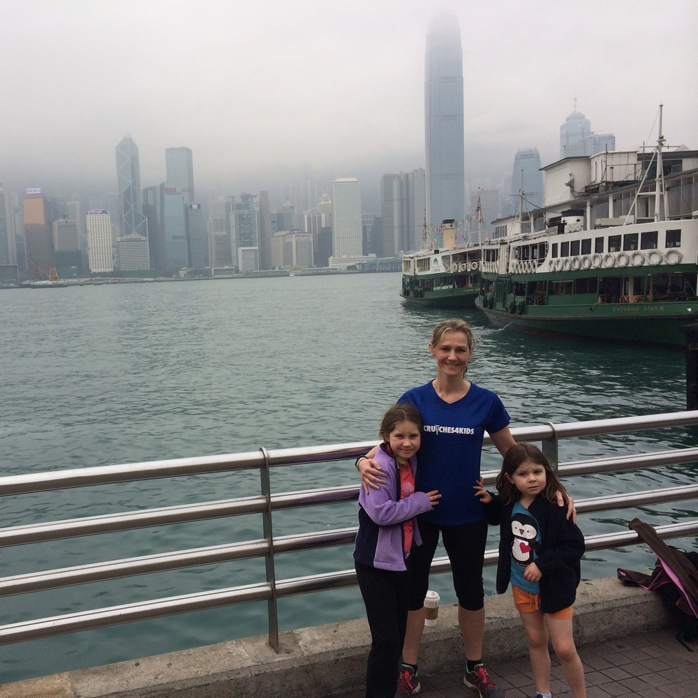 "Antonia Lewis-Iley in Hong Kong - ""I can't quite believe I am flying from Hong Kong to run the New York half, but I suppose that is what friends are for....to get you to do crazy things you would otherwise never think to do.  My training has included ""beating the banana"" in the 1km family fun run in Hong Kong this week, definitely a highlight, as our two girls ran their hearts out, and were so proud of their achievement...I have been humbled by the number of friends who have donated to our fund-raising page, in no small part to them seeing for themselves what an incredible charity Crutches4kids is wanting to help this awesome charity."""