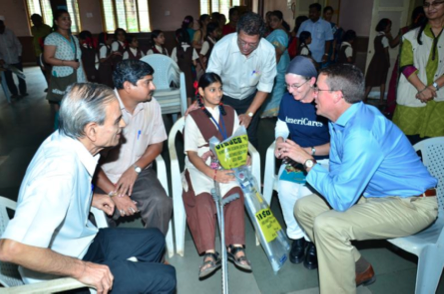 AmeriCares President & CEO Michael Nyenhuis oversees distribution of crutches at Asmita Jogeshwari.      Photo Courtesy of: AIF