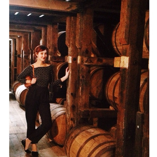Cardinal Spirits server Becky Button models the latest barrels.