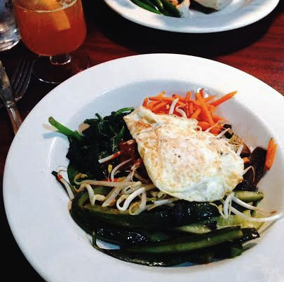 Dinner at Old Crown: The vegetarian bibimbap, a Korean dish of saut  ée  d veggies with a fried egg on top. Photo by Jaclyn Garver.
