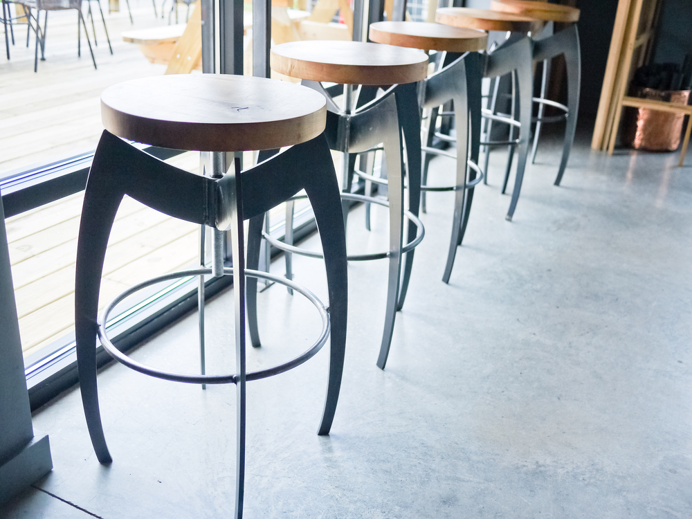 The bar stools at Cardinal Spirits.