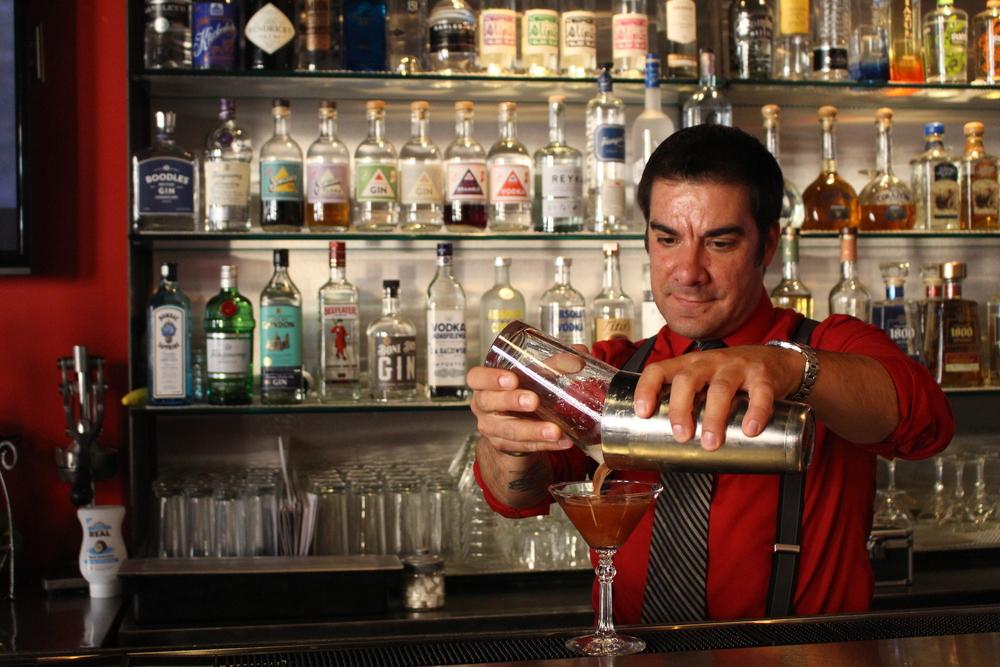 Aaron Morales prepares a drink