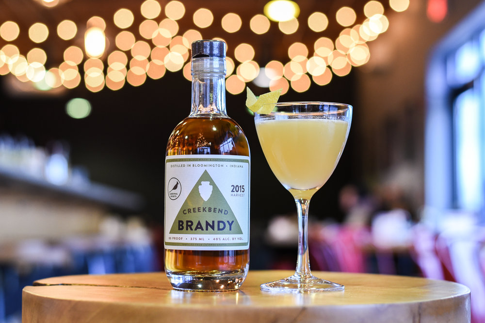 Creekbend Brandy - The perfect bottle for dinner parties — distilled with local Catawba grapes grown by Oliver Winery.By the bottle and in cocktails at the distillery!