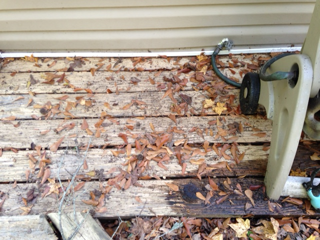 Look how awesome the wood looks after being pressure washed. See how dingy it was before(bottom right)?