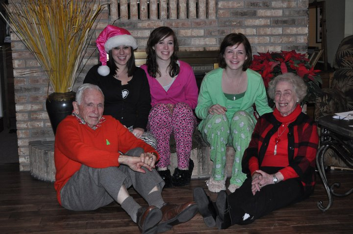 Sisters and me with my grandparents on Christmas Eve.