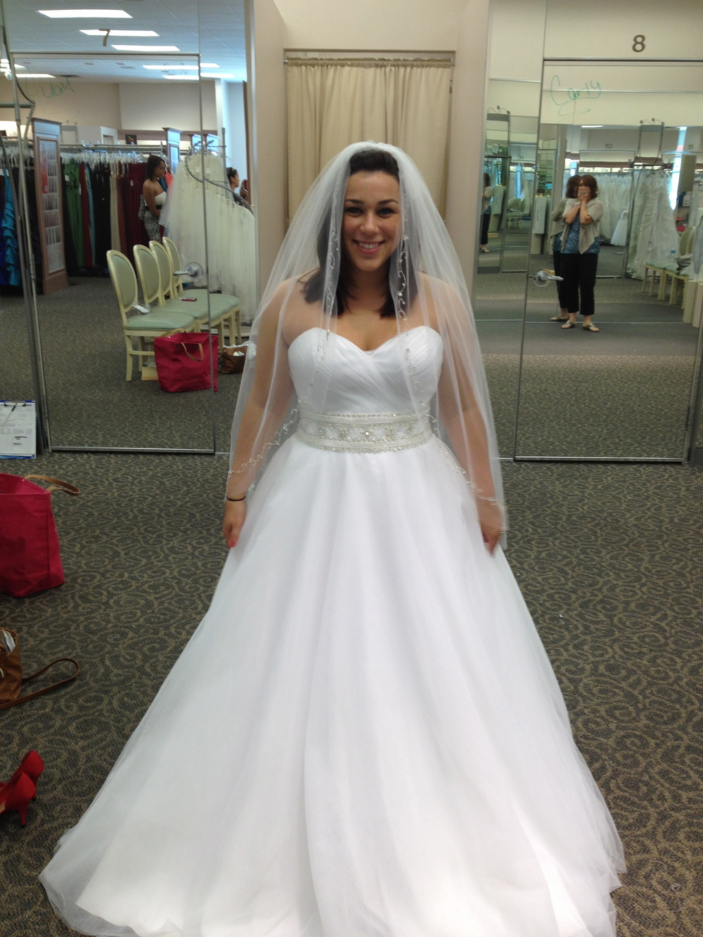This is me at David's Bridal. I chose the 6th dress that I tried on. I love my mom's face in the mirror :) Worth every tomato.