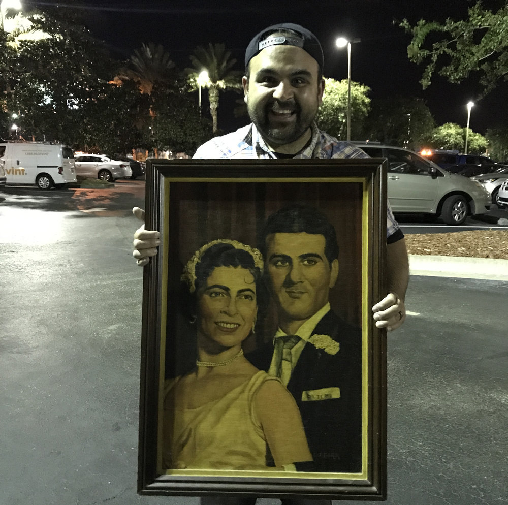 This is a portrait painting of Jason's grandparents on their wedding day. It's definitely sentimental, and also definitely huge.